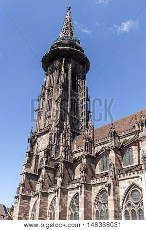 Main Tower Of World Famous Freiburg Muenster Cathedral, A Medieval Church In The City Of Freiburg