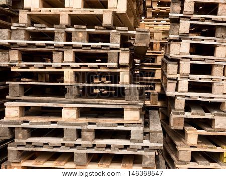 Wooden shipping pallets with in stock of cargo company, ready for using