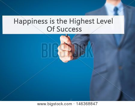 Happiness Is The Highest Level Of Success - Businessman Hand Holding Sign
