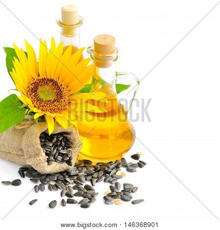 Sunflower Seeds On A Background Of Small Bag With Flower And A Bottle Of Oil