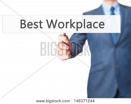 Best Workplace - Businessman Hand Holding Sign
