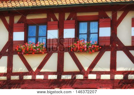 windows of a house with flowers. Nuremberg Bavaria Germany