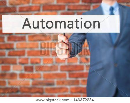 Automation - Businessman Hand Holding Sign