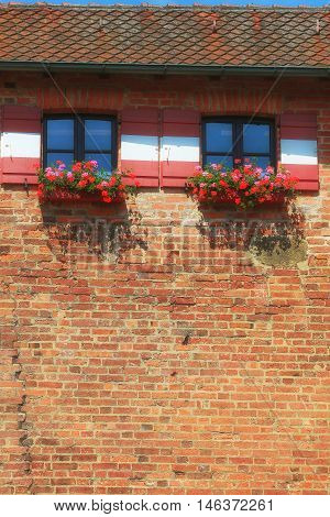 house with a roof and windows with flowers. Nuremberg Bavaria Germany
