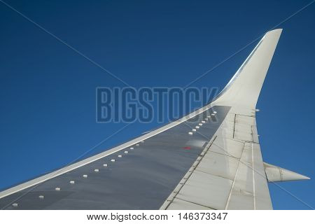 Aircraft wing view of blue sky from aircraft windows