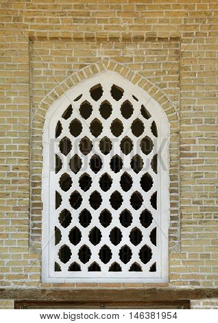 Typical open-work window of an ancient building, Uzbekistan