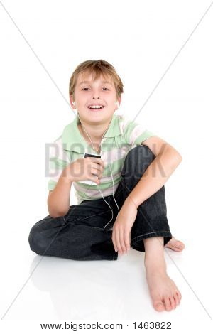 Casual Boy Sitting With Portable Music Player