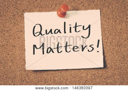 Quality matters note pin on the bulletin board