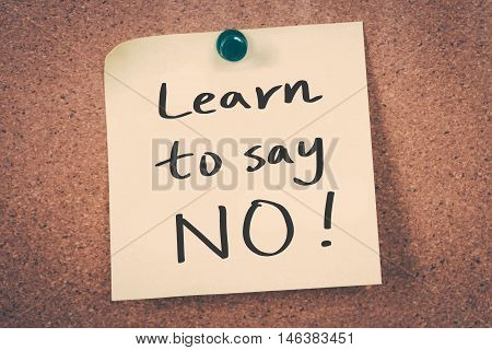 Learn to say no note pin on the bulletin board