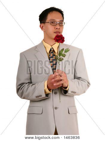 Biz Man Holding Red Rose