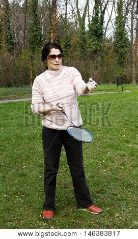 A lovely attractive sporty woman play tennis outdoors in the morning.