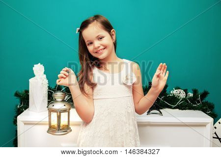 little girl with a New Year's flashlight. The concept of the New Year and Merry Christmas 2017