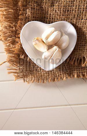 Garlic on a rustic hessian background.