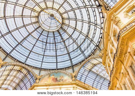 MILAN, ITALY - AUGUST 13, 2016: Architecture of the Vittorio Emanuele II Gallery. The famous mall connects the Piazza del Duomo to Piazza della Scala and contains shops, restaurants and hotels.