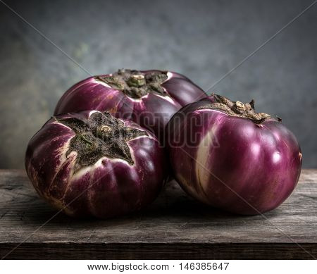 eggplant (Helios) on a wooden board.