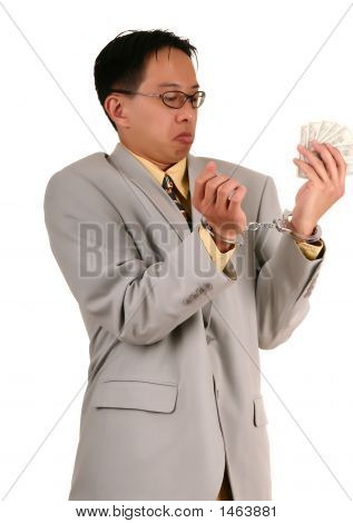 Confused Handcuffed Biz Man Holding Money 3