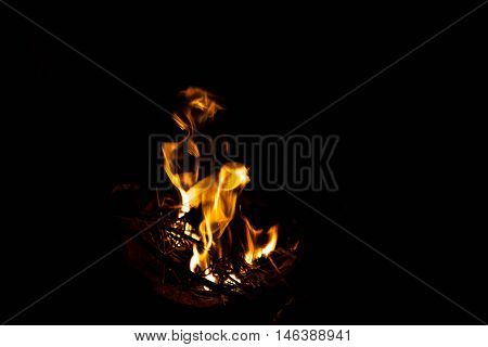 flame in a brazier on black background