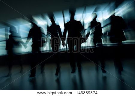 Blurred motion of business people