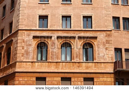 Windows of old house. Mediterranean architecture in Rome, Italy.