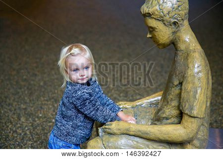 Wanaka, New Zealand - Febr 5, 2015: Pretty Little Girl By The Floating Bench In The Sculpt Illusion