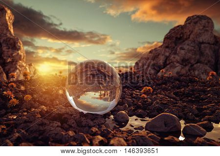 3d rendering of crystal ball on rocky terrain in the evening sunlight