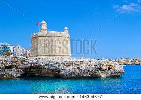 Castle of St. Nicholas or Castell de Sant Nicolau at the Ciutadella town port on a sunny summer day, Menorca island, Balearic islands, Spain.