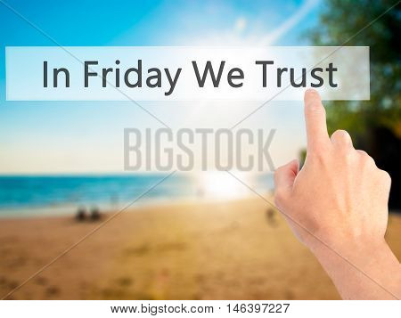 In Friday We Trust - Hand Pressing A Button On Blurred Background Concept On Visual Screen.