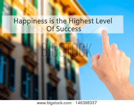 Happiness Is The Highest Level Of Success - Hand Pressing A Button On Blurred Background Concept On