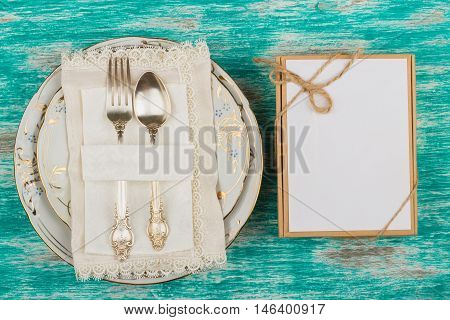 Tableware and silverware with a present box on the light background