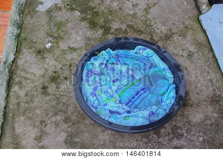 Soak dirty clothes in the basin black for clean Thailand  washing clothes style ancient