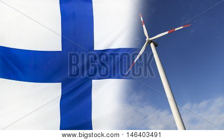 Concept clean energy with flag of Finland merged with wind turbine in a blue sunny sky