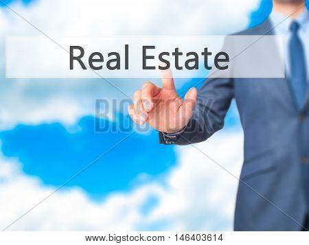 Real Estate -  Businessman Click On Virtual Touchscreen.