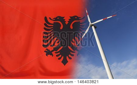 Concept clean energy with flag of Albania merged with wind turbine in a blue sunny sky