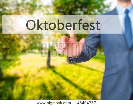 Oktoberfest -  Businessman Click On Virtual Touchscreen.