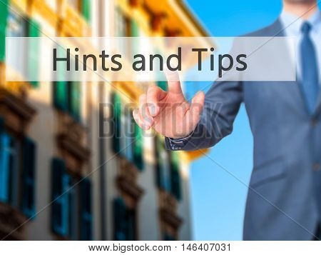Hints And Tips -  Businessman Click On Virtual Touchscreen.