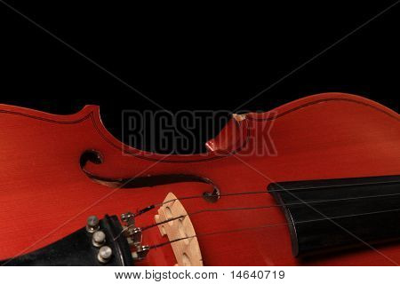 Close-up of a violin - isolated on black background