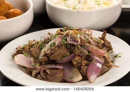 Portion Of Meat And Onion In The White Plate
