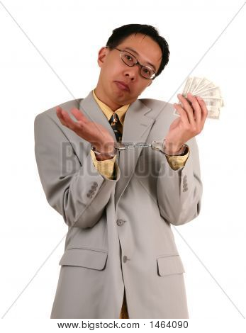 Confused Handcuffed Biz Man Holding Money