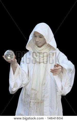White Wizard manipulating crystal balls  isolated on black background