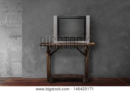 obsolete tv on old wooden in empty living room