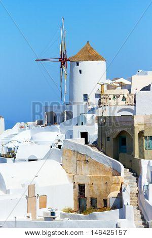 Famous windmill in Oia Santorini at daylight
