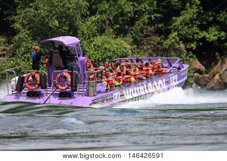 NIAGARA FALLS, CANADA - JULY 15, 2016. A popular tourist attraction the Whirlpool Jet Boat tour is a large jet boat that's sure to thrill and excite.