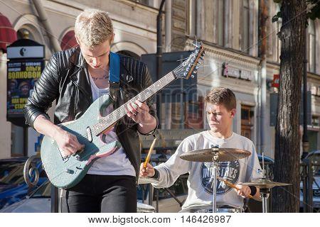 St. Petersburg, Russia-september 09,2016: The Street Musician Plays On The Street Of St. Petersburg.