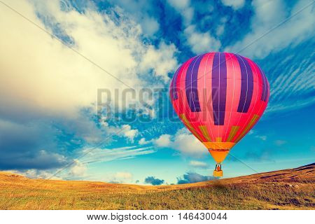 Morning flight of the hot air balloon above the countryside.