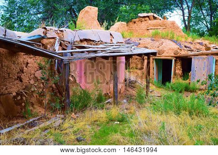 Historic collapsing adobe building which is centuries years old taken in Taos, NM