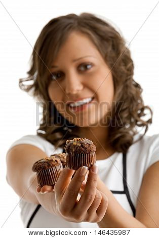 Young woman with chocolate muffin. Isolated on white background. Focus on muffins.