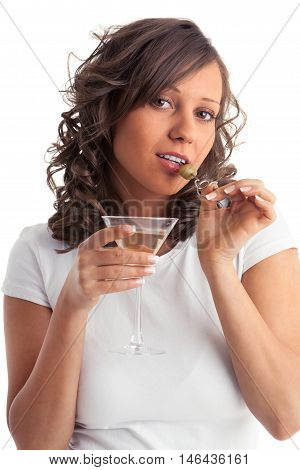 Young woman drinking martini isolated on white background. Waist up view.