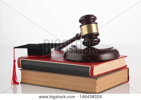 gavel hammer and mortar board on the white background