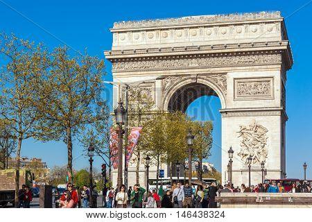 Paris, France - April 7, 2011: People Walking In Front Of Arc De Triomphe