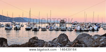 yachts and boats at evening sunset in port of Santa Margherita, Liguria